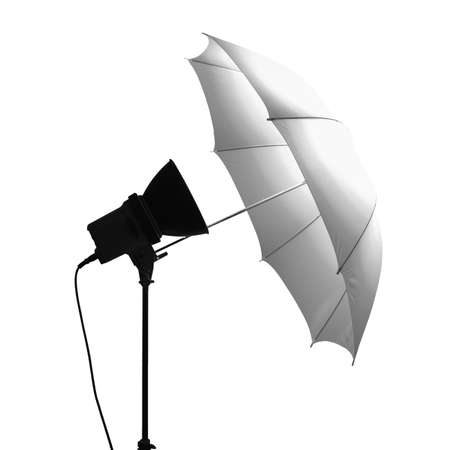 Light umbrella reflector used in photographic studio set isolated over white background