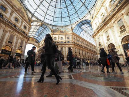 MILAN, ITALY - CIRCA JANUARY 2017: Tourists in Galleria Vittorio Emanuele II shopping arcade Editorial