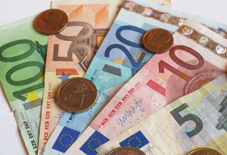 Euro (EUR) banknotes and coins, currency of European Union (EU) useful as a background