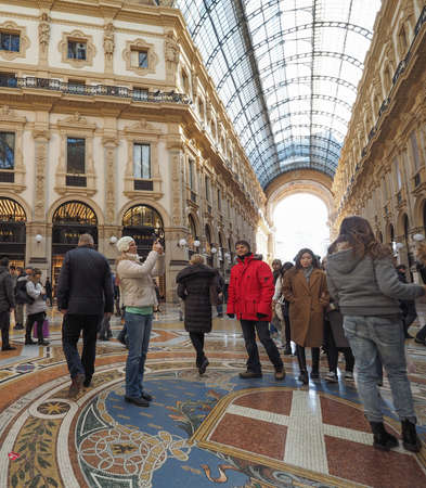prada: MILAN, ITALY - CIRCA JANUARY 2017: Tourists in Galleria Vittorio Emanuele II shopping arcade Editorial