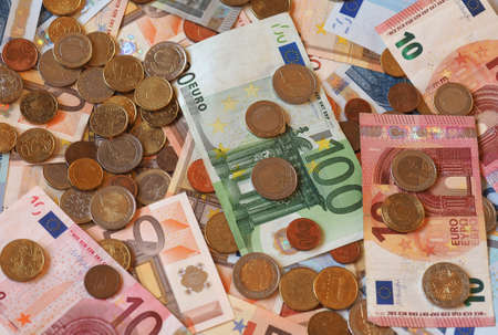 Euro (EUR) banknotes and coins, currency of European Union (EU)