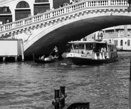 VENICE, ITALY - CIRCA SEPTEMBER 2016: Ponte di Rialto (meaning Rialto Bridge) over the Grand Canal in black and white Editorial