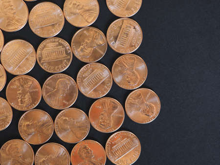 One Cent Dollar coins money (USD), currency of United States over black background Imagens