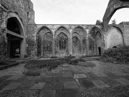bombed city: Ruins of St Peter church in Castle Park bombed during World War II and now preserved as a memorial in Bristol, UK in black and white