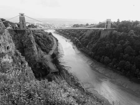 Clifton Suspension Bridge spanning the Avon Gorge and River Avon designed by Brunel and completed in 1864 in Bristol, UK in black and white Stock Photo