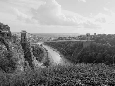 completed: Clifton Suspension Bridge spanning the Avon Gorge and River Avon designed by Brunel and completed in 1864 in Bristol, UK in black and white Stock Photo