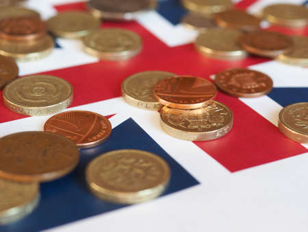 earn money: Pound coins money (GBP), currency of United Kingdom, over the Union Jack Stock Photo