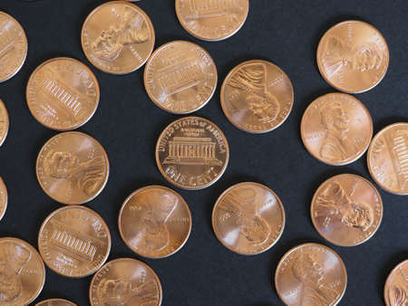 earn money: One Cent Dollar coins money (USD), currency of United States over black background Stock Photo