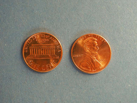 earn money: One Cent Dollar coins money (USD), currency of United States over blue background