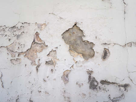 Damage caused by damp and moisture on a wall