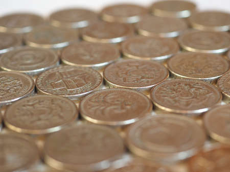 earn money: Pound coins money (GBP), currency of United Kingdom