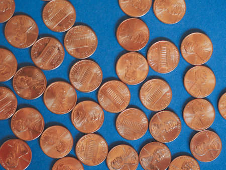 us dollars: One Cent Dollar coins money (USD), currency of United States over blue background