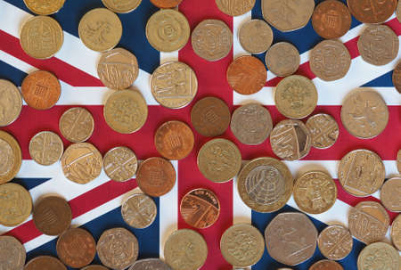 uk money: Pound coins money (GBP), currency of United Kingdom, over the Union Jack Stock Photo
