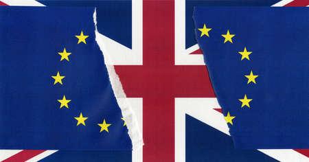 Torn European Union flag over Union Jack United Kingdom flag, symbol of Brexit