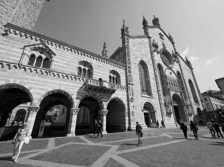 municipal editorial: COMO, ITALY - CIRCA APRIL 2017: Santa Maria Assunta Roman Catholic cathedral church and Broletto (town hall) in black and white