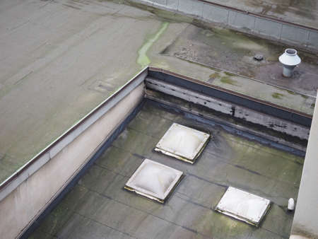 mould on a flat roof with sky windows Stock Photo
