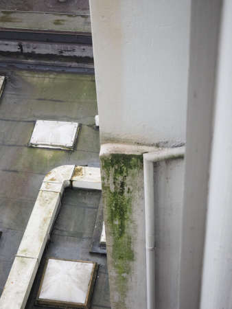 damage caused by damp and moisture on a wall and flat roof Stock Photo