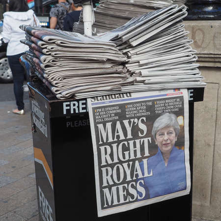 resulted: LONDON, UK - JUNE 09, 2017: Theresa May on the Evening Standard front page on the day after the general elections which resulted in a hung parliament Editorial