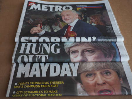 resulted: LONDON, UK - CIRCA JUNE 2017: Theresa May and Jeremy Corbin on the front page of newspapers on the day after the general elections which resulted in a hung parliament