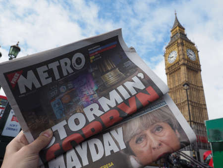 conservative: LONDON, UK - JUNE 09, 2017: Newspapers showing Jeremy Corbyn (Labour Party) and Theresa May (Conservative Party) in front of the Houses of Parliament the day following the 8 June general elections Editorial