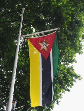 the Mozambican national flag of Mozambique, Africa Reklamní fotografie