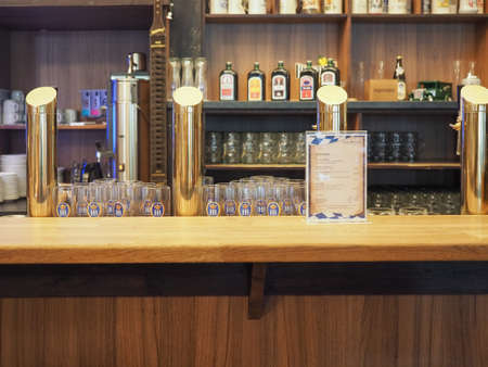 draughts: HAMBURG, GERMANY - CIRCA MAY 2017: Draught beers in a traditional German Bavarian public house