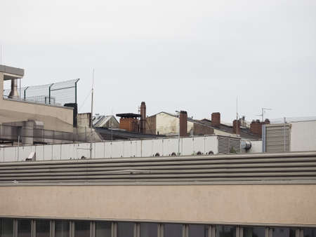 urban skyline with roof chimneys and air conditioning units and aerials Stok Fotoğraf