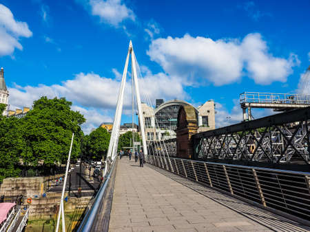 LONDON, UK - CIRCA JUNE 2017: Jubilee Bridge over River Thames links Charing Cross to the South Bank and Waterloo (high dynamic range)