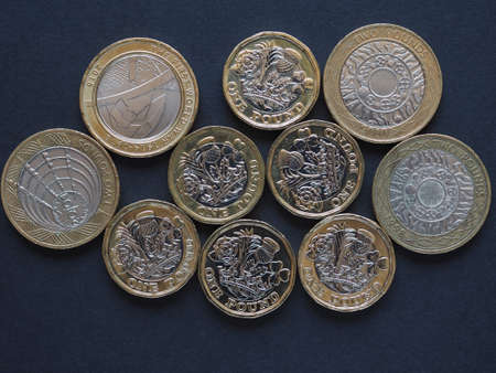 new 1 pound and 2 pounds coin money (GBP), currency of United Kingdom Stock Photo