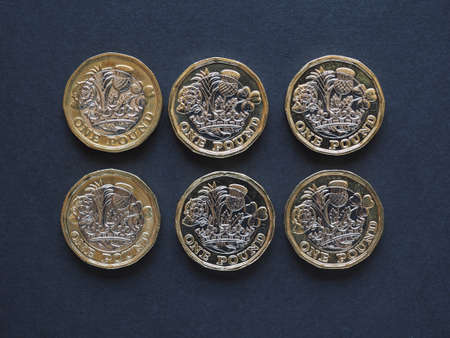 uk money: new 1 pound coin money (GBP), currency of United Kingdom Stock Photo