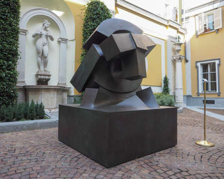 deposed: TURIN, ITALY - CIRCA AUGUST 2017: Stone sculpture entitled Sole Deposto (meaning Deposed Sun) by artist Gio Pomodoro outside Accorsi Ometto museum
