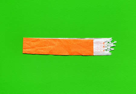 wristband used as event ticket, orange over green