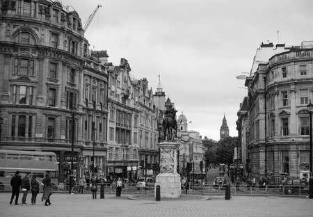 LONDON, UK - CIRCA JUNE 2017: People in Trafalgar Square in black and white