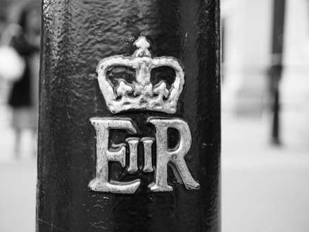 LONDON, UK - CIRCA JUNE 2017: Royal cypher of HM the Queen Elizabeth II (E II R) on a lamp post in black and white
