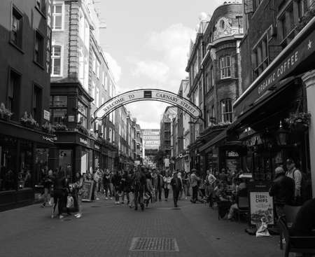 LONDON, UK - CIRCA JUNE 2017: Carnaby Street in Soho in black and white