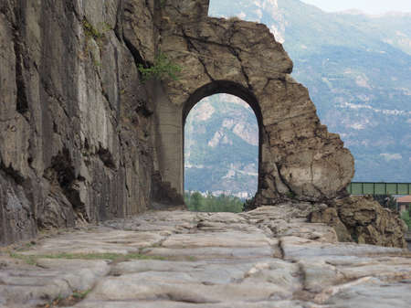 Ancient roman consular road stone arch in Donnas, Italy Stock Photo