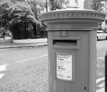 LONDON, UK - CIRCA JUNE 2017: red mailbox in black and white