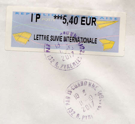 PARIS, FRANCE - CIRCA OCTOBER 2017: a stamp printed by France showing paper planes symbol of air mail (lettre suivie internationale means international signed for letter)