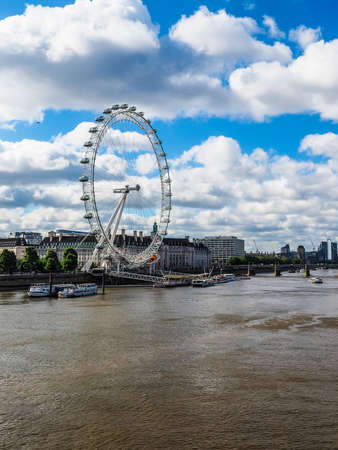 LONDON, UK - CIRCA JUNE 2017: The London Eye ferris wheel on the South Bank of River Thames aka Millennium Wheel, high dynamic range Editorial