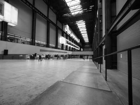 LONDON, UK - CIRCA JUNE 2017: Turbine Hall at Tate Modern art gallery in South Bank power station in black and white