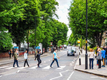 LONDON, UK - CIRCA JUNE 2017: Abbey Road zebra crossing made famous by the 1969 Beatles album cover, high dynamic range
