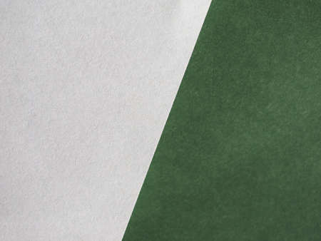 white sheet of paper over green leatherette texture useful as a background - focus on paper Stock Photo - 90995648