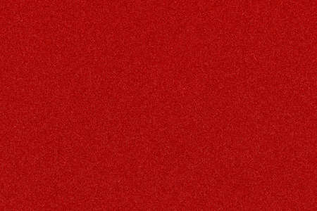 red texture with shiny speckles of random colour noise useful as Christmas background
