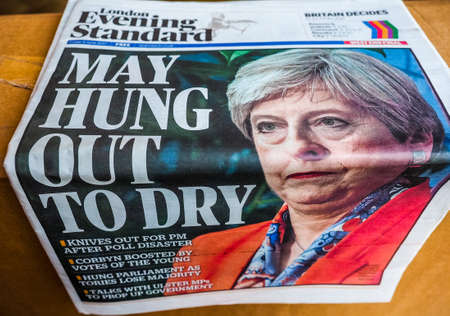 LONDON, UK - CIRCA JUNE 2017: Theresa May on the front page of newspapers on the day after the general elections which resulted in a hung parliament, high dynamic range Editorial
