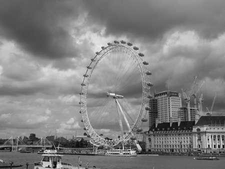 LONDON, UK - CIRCA JUNE 2017: The London Eye ferris wheel on the South Bank of River Thames aka Millennium Wheel in black and white Redakční