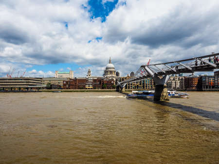 LONDON, UK - CIRCA JUNE 2017: Millennium Bridge over River Thames linking the City of London with the South Bank between St Paul Cathedral and Tate Modern art gallery, high dynamic range