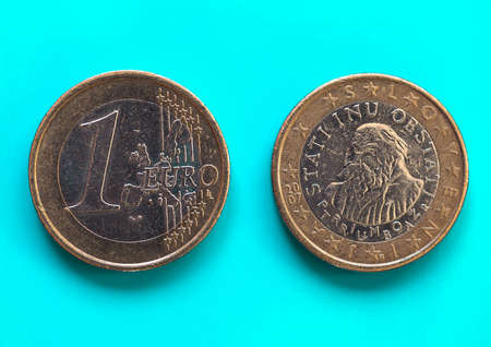 1 euro coin money (EUR), currency of European Union, Slovenia over green blue background