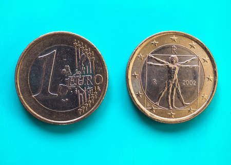 1 euro coin money (EUR), currency of European Union, Italy over green blue background Reklamní fotografie