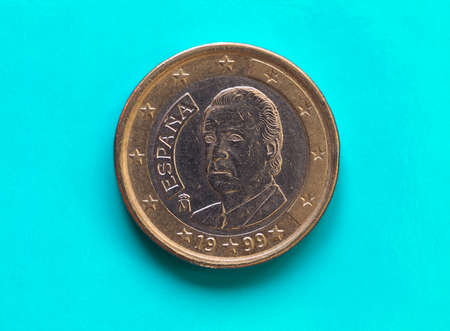 1 euro coin money (EUR), currency of European Union, Spain over green blue background Reklamní fotografie