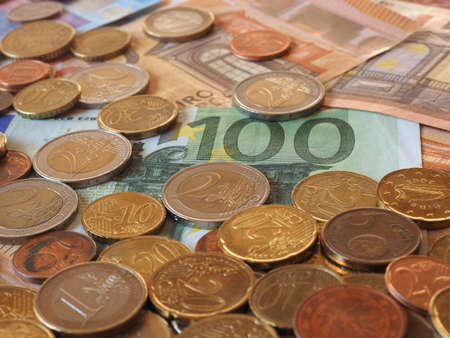 Euro banknotes and coins (EUR), currency of European Union Stock Photo